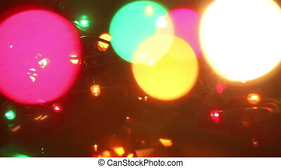 colorful flashing christmas lights and bokeh seamless loop