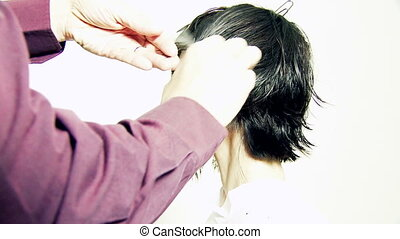 Female model getting short haircut - Hair stylist cutting...