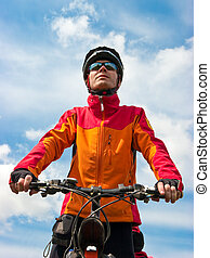 Cyclist - Portrait of adult cyclist on mountain bike against...