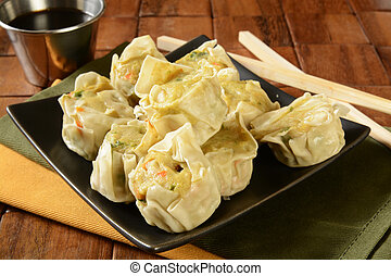 Chicken shu mai - A plate of Chinese chicken dumplings with...