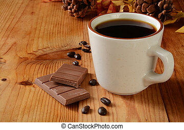 Milk chocolate and coffee - A milk chocolate bar and a cup...
