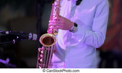 Saxophone Player In Action - Musician is playing on...
