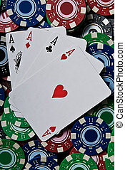 Four Aces - All 4 aces sitting on a pile of poker chips
