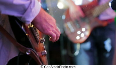 Two Guitarists Playing Guitar . Close-up