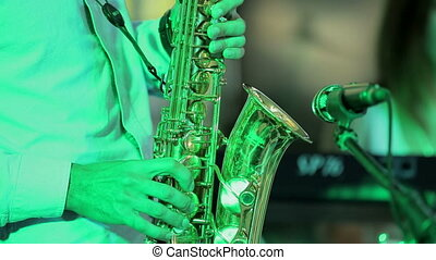 Musician Playing Saxophone. Close-up - Close-up on the...