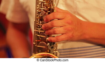 Musician Plays Saxophone. Close-up - Close-up on the player...