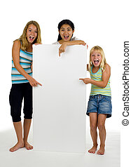 three young females with white board - three young females...