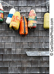Hanging buoy - A group of old buoys hanging on a wall near...