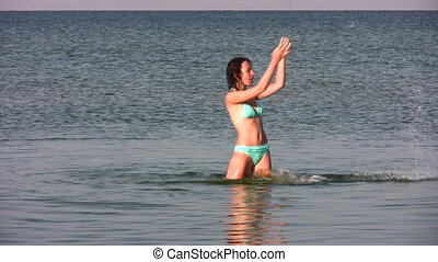woman splashing water - Woman splashing water