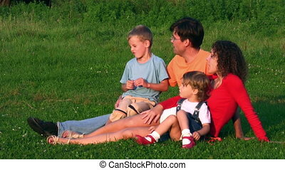 family of four on grass - Family of four on grass