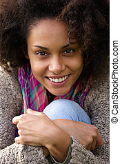 Close up portrait of a cute young african american woman...