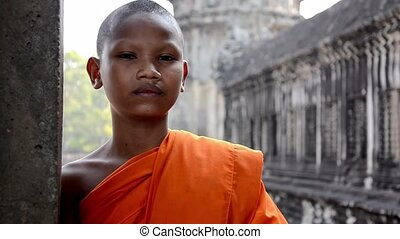 young buddhist monk portrait - cambodian monk in angkor wat...