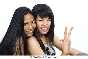making fun - two young asian women making fun