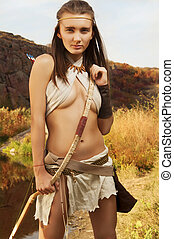 Primitive woman holding a bow. Amazon woman - Woman warrior....