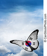 South Korea flag butterfly flying on sky background