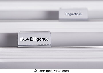 Due Diligence And Regulations Folders - Closeup of folders...