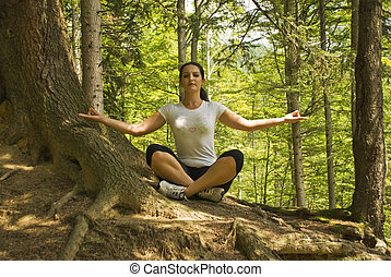 Yoga position in nature - Young woman doing yoga in nature...
