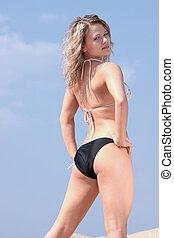 Beautiful blond girl in bikini taking sunbath