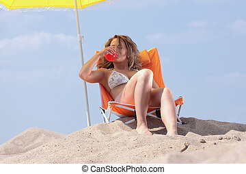 Beautifull blond girl in bikini sunbathing