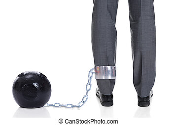 Businessman With Ball And Chain Attached To Leg - Low...