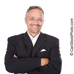 Smiling Mature Businessman Standing Arms Crossed - Portrait...