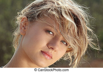 Blond fitness girl in wind portrait