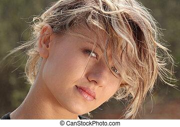 Blond fitness girl in wind portrait