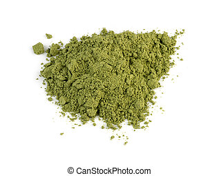 Macro closeup of organic wheatgrass powder isolated against...