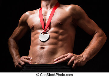 Sportsman with medal on his chest - studio shoot
