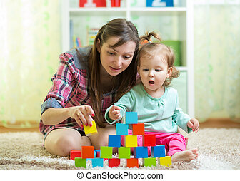 mom with her daughter play together