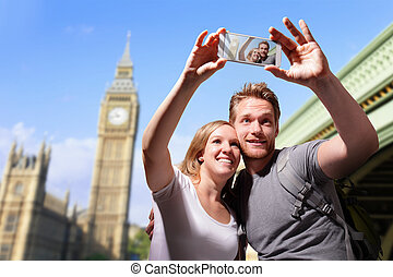 happy couple selfie in london - happy couple selfie by smart...