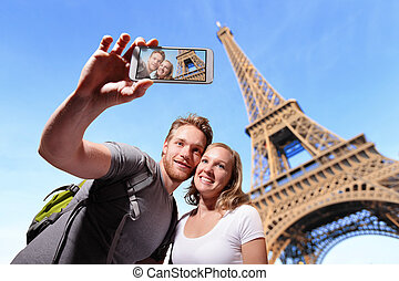 happy couple selfie in Paris - happy couple selfie by smart...