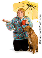Woman seeing whether it rains - Woman with her dog seeing...