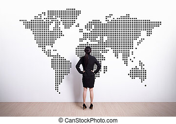 business woman look world map - Back view of business woman...