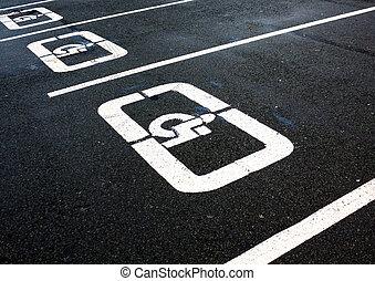 disabled parking sign on the asphalt