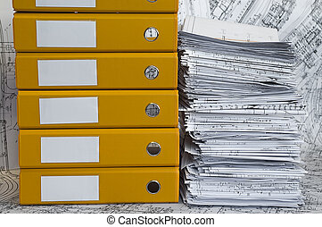 Heap of project drawings in yellow folder - Big heap of...