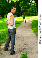 Woman and man staying in park