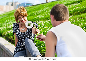First Date - Teenager gives flower to girlfriend....