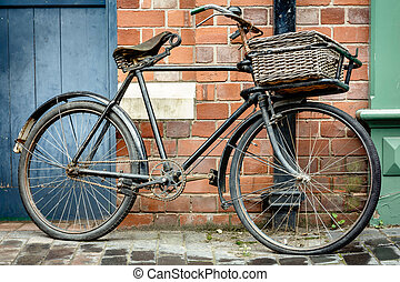 Vintage bicycle - Old retro cycle with basket leaning...