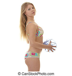 Young blond woman and a beach ball isolated on white...