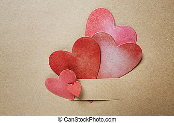 Hand-crafted paper hearts on earthy colored paper