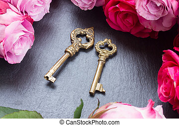 Keys with pink roses - Two keys with fresh oink roses as a...