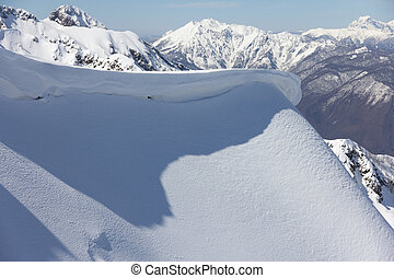 mountain slope and snow cornice - winter mountain slope and...