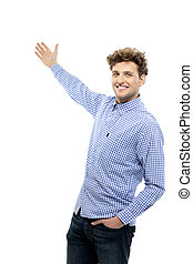 Portrait of a handsome young man gesturing welcome