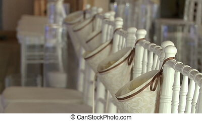 View of decorated chairs in banquet hall - View of decorated...
