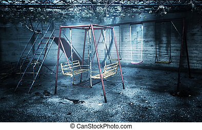 Old rusted playground, abandoned aged swings, destroyed...