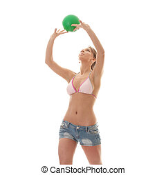 Beautiful woman playing volleyball (beach ball) isolated on...