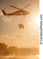 Blackhawk Helicopter carrying Humvee - A UH-60 Blackhawk...