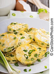 Mini frittatas with peas, green onion and feta cheese