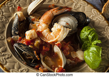 Homemade Italian Seafood Cioppino with Mussels, Clams, and...